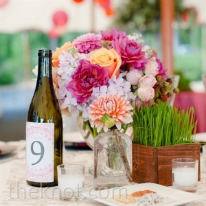 wine bottle and flowers on a table